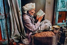 an old baba reading the Quran.