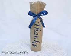 """This burlap bags perfectly fit wine bottles, olive oil bottles, beer bombers and many other things! Wrapped with a DARK BLUE satin ribbon, these make for beautiful gifts, centerpieces or wedding favors. This bag made of natural burlap,  with hand painted """"Thanks"""" sign the front in DARK BLUE- but I can paint your initials, any saying, name as a part of a custom order. If you need a quantity other than shown please convo me and I will set up a special listing for you for the quantity ..."""