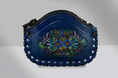 http://etsy.me/1R8dfLh $39.00 Handmade Leather Coin Purse, finished in a midnight blue stain, engraved and painted by hand, zippered closure, leather stitching and water resistant finish. Handy, unique and beautiful, these handmade leather coin purses are just what you need to keep coins, folded bills or keys. Keep track of the coins in you purse, car, desk and other places where they tend to scatter and disappear off into oblivion.