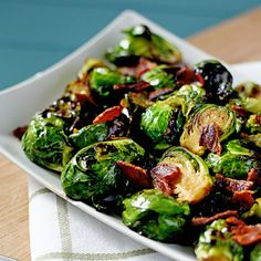 Lightly Brown Sugar Glazed Brussels Sprouts with Bacon Crumbles 3 slices of bacon 1 pound Brussels Sprouts, halved 1 clove garlic, minced teaspon salt teaspoon black pepper 1 tablespoons light brown sugar 2 tablespoons water Vegetable Sides, Vegetable Side Dishes, Side Dish Recipes, Vegetable Recipes, Dinner Recipes, Sprouts With Bacon, Bacon Wrapped Brussel Sprouts, Sprouts Food, Sprouts Recipe