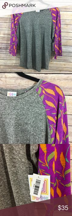 LuLaRoe Randy Tee Size L New with tags! Fits sizes 14-16 🚫 No trades! Reasonable offers and bundles accepted! LuLaRoe Tops