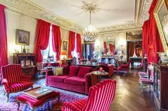 Classic opulence: The living room is decorated in rich colours, with an impressive chandel...