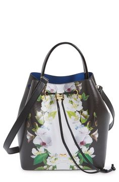 Painterly flowers in a mirrored print add romance to this structured bucket bag by Ted Baker.