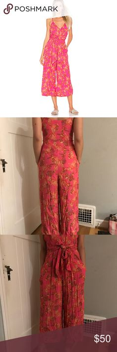 Tropical front tie jumpsuit Pink tropical print jumpsuit with front tie, culotte wide leg, and adjustable straps Free People Pants Jumpsuits & Rompers