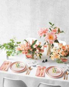 """Let single-bloom arrangements and pastel plates soften an otherwise all-white tablescape.From left: Green hellebores match up with Solomon's seal leaves, and hosta leaves complement French tulips. Peonies and Solomon's seal mingle in a tall vase, and finally, pale parrot tulips go solo to stunning effect. To useour editable place cards, download themhere.Iittala """"Aalto"""" vases, from $125;finnstyle.com. Kate Spade Saturday plates, from $10 each, and salt and pepper shakers, $35 for…"""