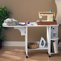 The Wildon Home Duncan Laminate Sewing Table snugly fits your sewing machine making it comfortable to use. This sewing table is made of wood and manufactu...