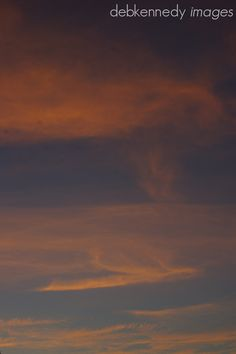 moments of grace 31 wednesday . wispy  sunset on the clouds of an incoming storm  light up the sky like an impressionist painting...