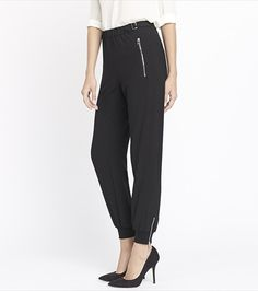 Go with the flow! These cuffed soft pants feature an edgy buckle details and elevated zipper closures.
