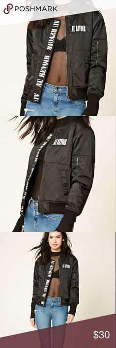 """Forever 21  Black Au Revoir Graphic Bomber Jacket A lightly padded bomber jacket featuring an """"Au Revoir"""" chest patch and zipper graphic, a zipper front, front snap-button pockets, long sleeves, a zipper sleeve pocket, and contrast ribbed trim. 100% polyester. Color: black Forever 21 Jackets & Coats"""
