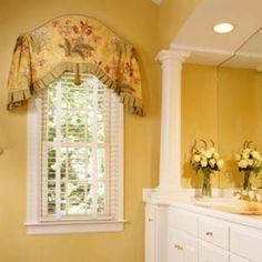 Love this!  Add an arch breaks up all of the straight lines.  Great use of a large scale pattern on a small window