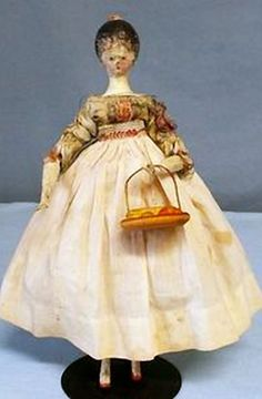 RARE 8.6 Inch Grodnertal wooden tuck comb jointed doll all original.