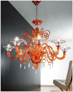 Outstanding high-end quality traditional classic orange Murano glass with touch of modern chandelier will compliment any of your interior design projects. This chandelier bright example of genuine Italian masterpiece glass artwork and handcrafted lighting orange Murano glass lighting.