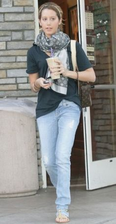 Ashley Tisdale wearing Louis Vuitton Monogram Denim Shawl, Louis Vuitton Multipli Cite Bag and Mystique Gold Gladiator T-Strap Sandal.