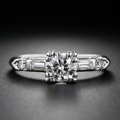 Platinum and diamond estate Engagement Ring with diamond baguettes