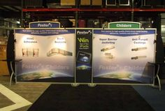 10' x 20' Trade Show Display Rental.  Includes (2) Backwall Workstations, (4) 50 Watt Halogen Arm Lights, (2) Arch Headers, and Tension Fabric Graphics.