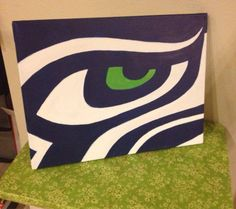 11x14 canvas, hand painted Seattle Seahawks logo Not a Seahawks fan? Message me and I can do your team!