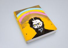 """One of a kind book hand painted by Massive Attack's that was auctioned in December 2014 with proceeds going to The Alzheimer's Society. The book is """"Collectors Edition"""" by Stuart Tolley, originally published in August Stuart Semple, Victor Pasmore, Sean Scully, Oliver Jeffers, Chuck Close, Massive Attack, Peter Blake, Herb Lubalin, Yayoi Kusama"""