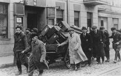 Jews deported from Prague move their belongings through the streets. Lodz ghetto, Poland, November 20, 1941.