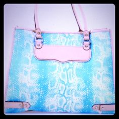 """Rebecca Minkoff Aqua Python Print Authentic Bag  Christmas SaleRebecca Minkoff Aqua Python Print handbag.  Guaranteed Authentic. Measures: L: 16"""" x W: 7"""" x H: 13"""". Strap L: 20"""". There is minor wear in this bag as I've only used it 1-2 times. #Rebecca Minkoff #handbag #shoulder-bag #python-print #aqua #bag #gift-ideas Rebecca Minkoff Bags"""