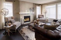 Neutrals with neutral window treatments & brown leather couch