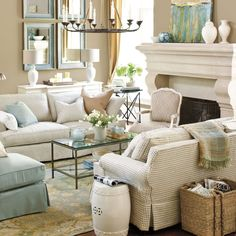 Take the plaid couches out, replace with same neutral colors and this would be a perfect modern rustic country living room. Very pretty.