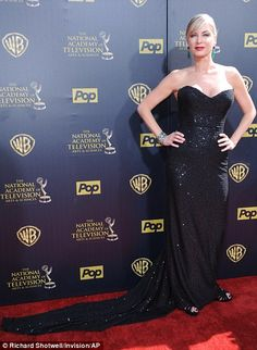 Dark side: Melissa RIvers (left) looked elegant in a strapless number featuring a whilte floral detailing while Eileen Davidson shimmered in a very long black dress