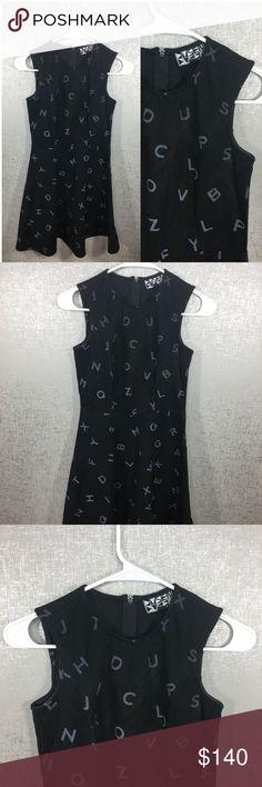 "Dusen Dusen Black Alphabet Print Dash Tennis Dress Dusen Dusen Anthropologie Black Dash Tennis Dress Alphabet Print Size 0. Excellent condition. Underarm to underarm is 13.5"". Top to bottom is 29.75"". Anthropologie Dresses"