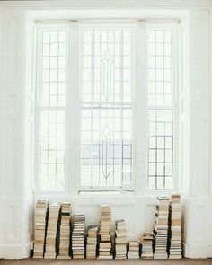 simple stacks of books against a bright window