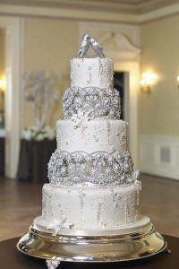 Silver wedding cake...just needs a different topper.