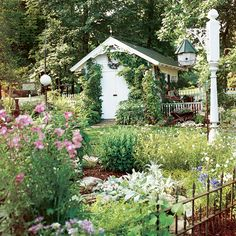 Gingerbread Potting Shed - As cute as it is useful, this all-white, gingerbread-trimmed potting shed anchors the back corner of a flower-filled cottage garden. Dream Garden, Garden Art, Garden Sheds, Backyard Sheds, Garden Tips, Garden Plants, Garden Design, Play Houses, Bird Houses
