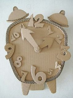 Cardboard Clock DIY Make a Cardboard Clock and let your children decorate diy ideas with cardboardEnjoy this list of creative cardboard crafts, and make your own creation. Do not worry about whether you are wasting anything, because cardboard c Cardboard Sculpture, Cardboard Toys, Cardboard Furniture, Cardboard Crafts Kids, Cardboard Chair, Kids Crafts, Diy And Crafts, Arts And Crafts, Decor Crafts