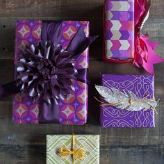 Print these pretty gift wraps for your New Year's Eve gifts. Four modern and deco patterns to choose from.