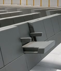 Genya by Lamm | seating | university furniture. Designed and created specifically for the Aula Magna at the new Bocconi University campus in Milan, the Genya armchair uses the stylistic features, minimalist spirit and austere appearance of the building designed by Grafton Architects. When closed, the seat has the appearance of a compact wall, in which all possible sources of disturbance are designed to remain hidden within the volume.
