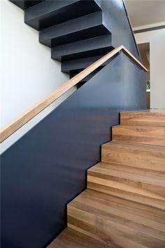 dark metal balustrade with a wooden handrail