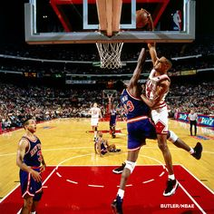 The New York Knicks stand by as Scottie Pippen dunks on Patrick Ewing. Photo courtesy of NBAE/Nathaniel S. Butler