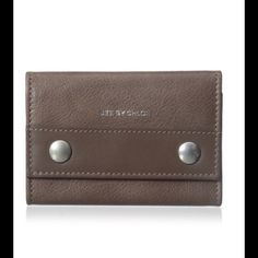 """See by Chloe Leather Key Case Taupe leather with silver snaps and logo key case accommodates up to six keys. 3""""H X 4""""W X 0.5""""D Comes with dust bag and authenticity card. Brand new. No trades. See by Chloe Accessories Key & Card Holders"""