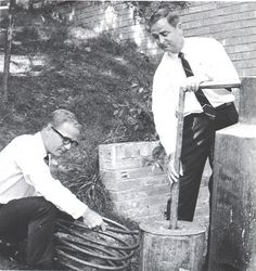 1968 East Tennessee State University English Professors put together display of moonshine still for Homefolks Festival held on campus.