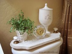 A Stroll Thru Life: Easy DIY Bathroom Tray This is a nice way to dress up/cover up an ugly toilet.