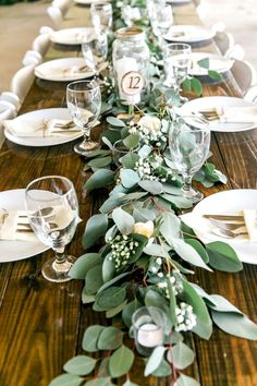 Long Feasting Table with Garland Greenery Centerpieces and Wooden Farm Tables Rustic, Country Wedding Reception Decor Inspiration Greenery Centerpiece, Greenery Garland, Long Table Centerpieces, Garland Decoration, Greenery Decor, Rustic Table Decorations, Wooden Wedding Centerpieces, Centerpiece Ideas, Branch Centerpieces