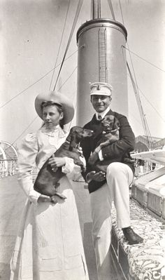 Prinzessin Viktoria Luise and brother Prinz August Wilhelm (yes, the UNfamous Awie) with some of their dachshund. Mids 1900s.  Im impressed to see a good image of August Wilhelm with a soft and tender smile and actually.looking handsome!