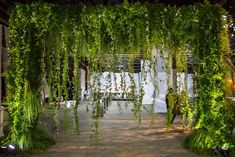 Foliage used in the entry gate to the event included passion flower vine, plumosa fern, ming fern, steel grass, and sheet moss.   Photo: Christian Oth Studio