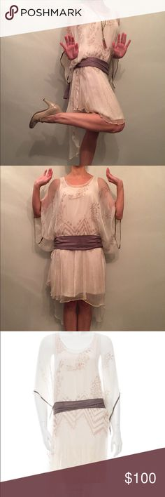 """Day Birger Et Mikkelsen High Low 20s Style Dress Day Birger Et Mikkelsen High Low 20s Style Dress. Sheer cream color with purple and light yellow patterns. Polyester, comes with full slip and purple sash. Pulls over head. Only the slip is fitted at bust, waist, & hip. 34C bust, 27"""" waist, 35"""" hip. Shoulder to hem on slip 37"""". Shoulder to front hem on dress 42"""", to back hem 45"""". Worn twice. Only listing for 6 weeks then will place with high end consignment. Day Birger Et Mikkelsen Dresses…"""