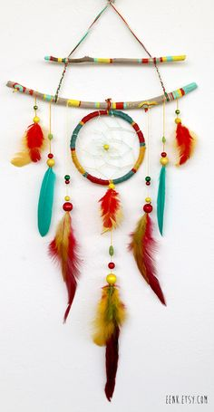 The Shamans Journey- A Native Rasta Dream Catcher Feather Mobile. Love this, love how the sticks are painted.