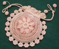 Vintage Romance Purse. Some things never go out of style, like this intricately crocheted rosey purse, lined with soft pink silk.
