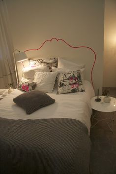 fake headboard - make it with washi tape! tape up some fabric - staple it into the wall and tape over it
