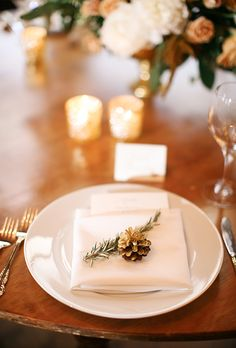 Brides.com: . A pinecone and an evergreen sprig were the perfect accents on this couple's place settings.