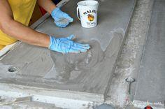 apply-slurry-to-DIY-concrete-vanity-counter-top-H2OBungalow