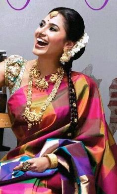 Indian fashion. Silk saree with blouse. Braided hairstyle. Gorgeous heavy gold jewellery. Jhumkis. Statement ring. Necklaces.