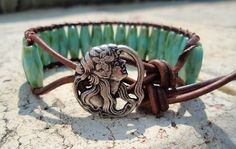 Three of my favorite colors in a super cool bracelet!    http://www.etsy.com/listing/77178207/bohemian-leather-bracelet-rustic-flower