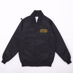 Wtaps Team Jacket - Must have new Team Jacket from Wtaps!  The classic piece features a premium nylon shell, quilted lining, branded tonal button closure, two front pockets, logo patch at chest, woven WTVUA detailing across back, plus iconic Wtaps branding throughout.  Joint the team!
